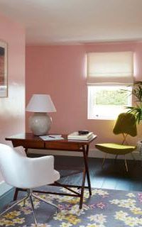 Donna's home office has walls painted in Middleton Pink by Farrow & Ball, and a floral rug from John Lewis that 'looks like it could be from The Rug Company'