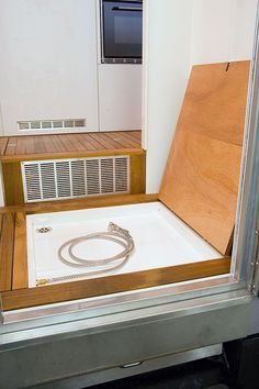 Small RV Trailers Bathroom - lift up the floor to reveal the shower tray