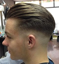 A lower but still aggressive fade with a very subtle undercut otherwise