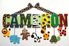 Adorable name signs- going to try to make something like this for the twin's jungle nursery :)
