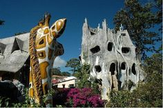 """The Hang Nga Guesthouse, or """"Crazy House,"""" in Vietnam is a testament that no window shall be round or square, that 90-degree angles simply should not exist. Unique is an understatement for this hotel, with its randomly winding hallways, giant giraffe and many strange windows. Vietnam travelers, be sure to pop in for a cup of tea."""