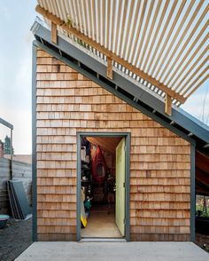 Freedom in 704 Square Feet - NYTimes.com - storage shed with slanted green roof
