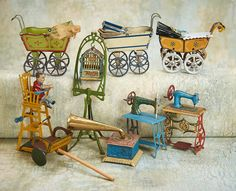 """German Lithographed Tin Penny Toys  2 1/2"""" (6 cm.) carriages. 6""""h. bird cage pedestal. Each is of pressed tin with lithographed designs Germany,early-20th century."""