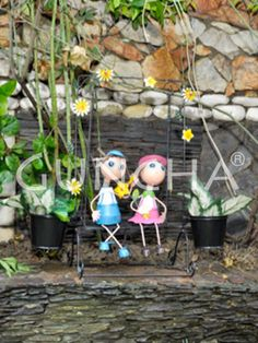 Friends on swings!! Elevate the charm of your garden area or living area with this coloured planter.