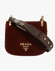 """Prada's new Pionnière is everything I want in a fall bag. It's small, but deceptively roomy; has a thick, comfy leather strap; and it comes in the richest chocolate brown velvet. If only I could get my hands on it in time for Fashion Week!"""