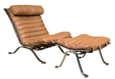 """Chair & Ottoman by Arne Norell A leather & steel """"Ari"""" lounge chair with ottoman by Swedish designer Arne Norell. Dimensions of ottoman : 16"""" high x 26"""" wide x 19.5"""" deep. Seat height of chair : 16"""" sloping down to 12"""".  Circa 1930 - 1970.  36 D x 26 W x 31.5 H"""
