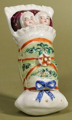 Porcelain trinket box formed as babies in a bunting, Germany, circa 1850
