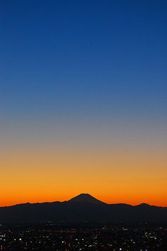 """Mt. Fuji ... The coloring in this picture so looks like a wall tapestry that I made back in 1994 called """"South of Sunset"""". I always have believed that I was Japanese in a prior life ... I wonder if this was deep in my memory???!!! Spooky, but cool!"""