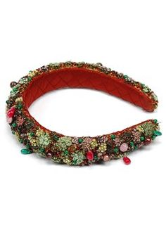 An oxblood and green fully thread embroidered hairband in quilted satin base encrusted with stones and sequins Shop Now at www.carmaonlineshop.com #carma #carmaonlineshop #ZardoziCapsule #headband #AccessoriesBySabyasachi #luxury #Indian #craft #heritage #shopnow #onlineshopping