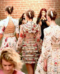 Zimmermann Spring 2016 in NY. They used many lovely flower dresses. Back details are see through. There are straps and fringe on the clothes as well.