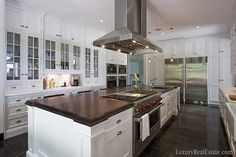 @Laura Copeland: Christopher Peacock has wonderful kitchen designs. I think you might like his use of wood surfaces + white cabinets.