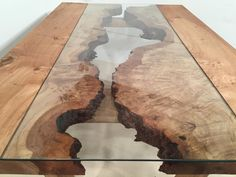 This CANYON table began as a gorgeous single slab of pippy oak and we think it would have been rude to do anything but show it off at its best.