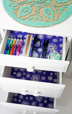 How to line your drawers with wallpaper - what a cool surprise every time you open them.