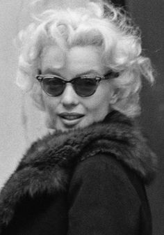 """…the owlish black sunglasses that dramatized the vanilla-pallor of her dairy-fresh skin."" - Truman Capote on Marilyn Monroe"