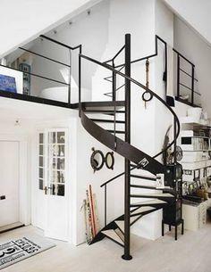modern industrial loft with black spiral staircase Loft Staircase, House Stairs, Spiral Staircase, Iron Staircase, Attic Stairs, Staircases, Loft Studio, Studio Interior, Home Interior Design