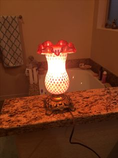 There are a pair of these Fenton cranberry lamps for Brandi!