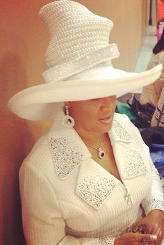 Tall beaded hat - But every woman that prayeth or prophesieth with her head uncovered dishonoureth her head: for that is even all one as if she were shaven. 1 Cor 11:5