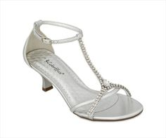 Stick your toes into these rhinestone embellished t-strap sandals and head off to the ball of your dreams. Featuring an adjustable ankle strap, fashionable covered heel, manmade sole and upper. From the last hole to the buckle on a size 7 it is approximately 10.5 inches long. Available Colors: Ivory Patent, Silver Metallic.