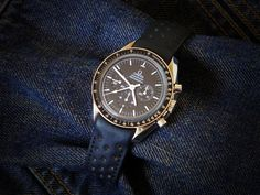 Omega Speedmaster on an OEM Omega 98000024 Rally Strap with the 94521813 deployant buckle (with curved ends.) (Click on photo for a slightly larger image.) Photo found here: http://forum.tz-uk.com/showthread.php?218167-The-ever-changing-looks-of-my-Speedmaster-Sapphire-Sandwich