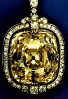 The Ashberg diamond is a 102.48-carat, amber-colored, cushion antique modified brilliant cut diamond.