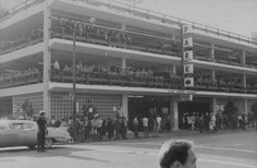 Oct 20, 1967 Vietnam War protests - The photograph shows members of 42 outside law enforcement agencies, called in under mutual aid agreements, who turned the Clay Street Garage into a garrison against demonstrators during Stop the Draft Week in Oct. 1967. The route of the marchers would pass the heavily fortified garage before reaching the Oakland Armed Forces Induction Center at 14th and Clay streets.