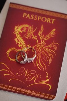 Passport wedding invitations bearing the Dragon and Phoenix symbols