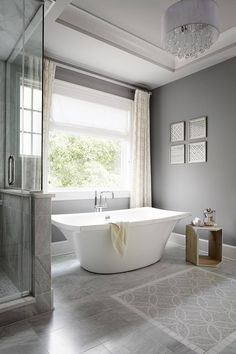 Soft grey tiles next to patterned - this is what it might look like to switch flooring for the closet and laundry room Interior Design Ideas