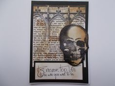 a card in browns and black, the skull stamp is by Visible Image, the text from a set by Katzelkraft, the arches are from a stamp set by Darkroom Door, and the background is a bookpage from an old German book I found in a thrift store.