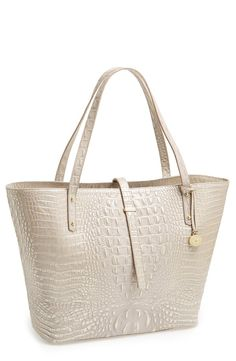 Metallic-brushed croc embossing elevates the exoticism of a structured leather tote accented with gleaming goldtone hardware
