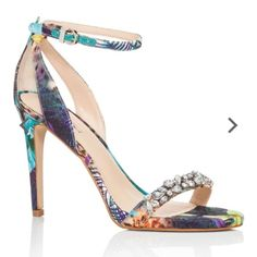 Guess Floral High Heels! Bring some trendy tropical-inspired style to any ensemble with these strappy stiletto heels from GUESS, which feature a vibrant floral print and glamorous rhinestone embellishment along the vamp strap. Gently used! Guess Shoes Heels