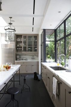 Photos via: Robinson + Grisaru Architecture Absolutely love the wall of windows, taupe cabinets,...