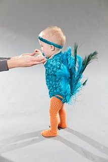 I know I don't have a girl baby but I wonder if my boy could pull it off?  Cute!  Actually, the pretty peacock are male, I guess I could do it!