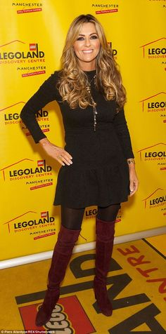A touch of glam: Dawn Ward stunned in an LBD and red suede over the knee boots...