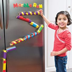 Marble run made with a collection of cardboard tubes.  Let your kids assemble — and reassemble — the run with the tissue box at the bottom on the floor to catch the speeding marbles.