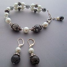 @Overstock - This elegant bracelet & earring set was carefully handcrafted with soft white crystazzi pearls, & beautiful black cracked glass beads. This stunning bracelet & earring set is both versatile & unique, it's sure to attract compliments from many admirers!http://www.overstock.com/Main-Street-Revolution/Heavenly-Beads-Elegant-Black-and-White-Bracelet-and-Earring-Set/6753392/product.html?CID=214117 $27.89
