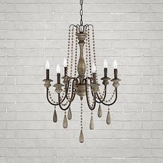 I love the rustic, chic look of the Louise Chandelier, it's going to be perfect in my outdoor living room.