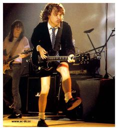 AC/DC Angus Young Plays Guitar Wearing Striped Necktie AC/DC's lead guitarist Angus Young might be among the top 100 greatest guitarist ever, ranking number 24 according to Rolling Stone but I have a certain fondness for the devilish rocker that seems unnatural for such an icon of Rock and Roll. It is his love of neckties that appeals to me especially. Click to read the rest of this and watch the video ACDC Thunderstruck love at River Plate