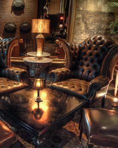 ❦ Love these leather chairs - but a question comes to mind:  why do decorators place chairs so close to tables that a person has to move the furniture in order to sit down? A petite lady would find it difficult to sqeeze into this space, much less a man with size 12 shoes...[ so they could fit all the chairs in the picture]