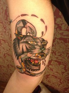 Tiger biting a snake. Traditional tattoo, done by Alejando Ferrer Acosta, in Barcelona