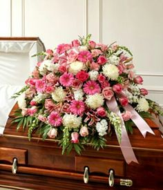 Features this gorgeous,bright casket spray makes a statement! Full of long stem pink roses, Asiatic lilies, white football mums or spider mums and more. Arrangement measures approximately x Casket Flowers, Funeral Flowers, Funeral Floral Arrangements, Flower Arrangements, Funeral Caskets, Funeral Sprays, Flowers For You, White Flowers, 800 Flowers