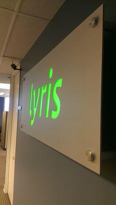 Lyris backlit aluminum panel sign