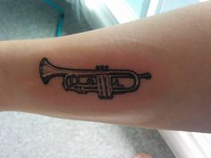 My first tattoo! My trumpet done by Sean at Vancouver Island Tattoo in Cumberland BC. Couldn't be happier!