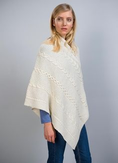 Maire Aran Wool Poncho - The stunning Maire wool poncho is crafted from soft and luxurious merino wool. Inspired by the tradition and history of the Aran Islands with cable, moss and honeycomb stitches featured throughout.