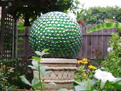 Homemade Gazing Ball something like this in the middle of the azaleas for her imagination to run wild