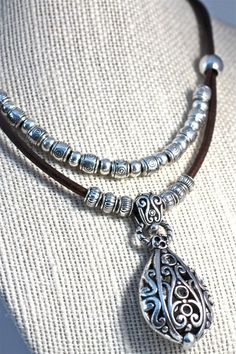 Scroll Work Silver Pendant Necklace Hip Leather by amyfine on Etsy #Silver  #Pendant