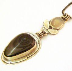 Black Swan - Hematite and Moonstone by SCJ Jewelry Design, via Flickr