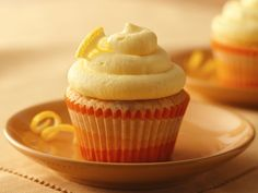 Ligthly Lemon Cupcakes.  Delish!!!  If you don't want so much frosting on each cupcake, one batch of frosting will frost 2 batches of cupcakes.  I had to work to make one batch of frosting fit on just 12 cupcakes.  They were easy and delish!