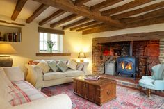 The lounge with woodburning stove set in original inglenook with old bread oven - Shere cottage rental Cottage Lounge, Cottage Living Rooms, Cottage Interiors, Home Living Room, Living Room Decor, Living Spaces, House 2, Inglenook Fireplace, Fireplaces