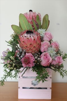 Pink Protea, Scabiosa and Roses, floral Mother's Day arrangement presented in a wooden Pallet style box. Florist based in Lincolnshire and Nottinghamshire.