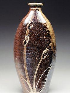 Alex Matisse; woodfired bottle with slip design.